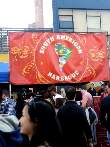 "Crowd in front of a sign readg ""South American Barbecue,"" at the Spanish Festival 2013"