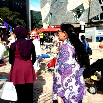 Women walking through the Viva Victoria Festival, Melbourne 2015
