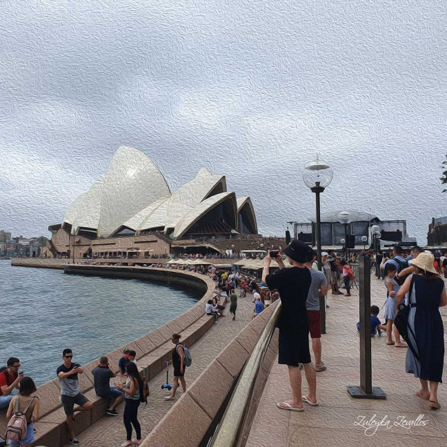 People walking in Circular Quay, Sydney, with the Sydney Opera House in the background