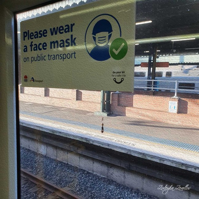 Sticker on the window of a train, says: Please wear a mask on public transport